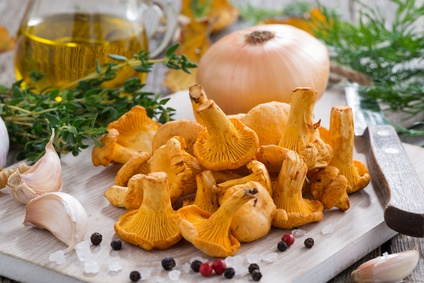fresh chanterelles and ingredients for cooking